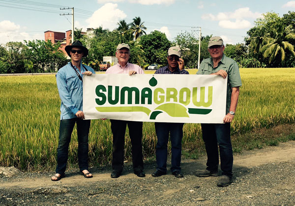Ethan Currie, Field Services Coordinator, with a group of farmers in the Domincan Republic